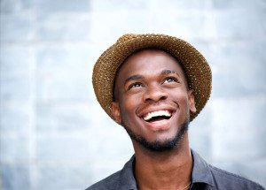 36347666 - close up portrait of a cheerful young man laughing and looking up