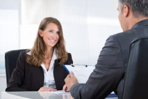 47562136 - mature manager interviewing a female applicant in office