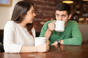 Attractive couple talking in a coffee shop