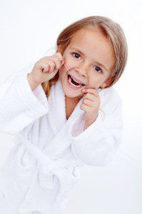 19981262 - little girl flossing - oral hygiene education in childhood